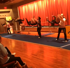 Students from Heart of the Valley YMCA give a tumbling demonstration prior to Cirque Peking.
