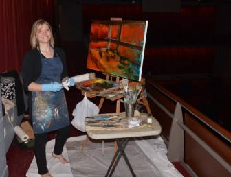 Artist XXXX paints the Kimberly-Clark Theater during Cocktail Hour of the Chairman's Gala on May 21